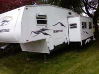 29Ft Fifth Wheel with large slide out. Three bunks in