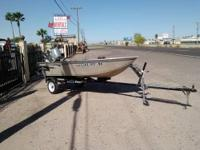 This is a 12 ft Triton Aluminum Boat and comes equipped