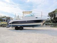 This 2005 Aquasport 275 Explorer WA is powered by Twin