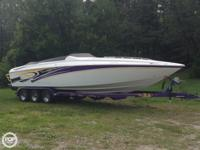 This 2005 Baja Outlaw 30 boasts twin 496 MAG HO