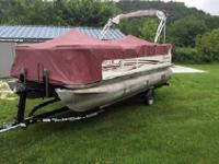 with low hours, this pontoon boat is ready to go. She
