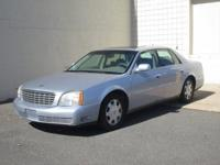 You are looking at a Blue, 2005 Cadillac Deville. This