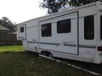 Early 2005 large 5th wheel camper. Great condition.