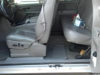 2005 Chev. Silverado extended cab ( 4 doors , two
