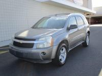 You are looking at a gray, 2005 Chevrolet Equinox. This