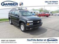 Featuring a 5.3L V8 with 164,921 miles. Includes a
