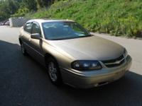 2005 Chevy Impala equipped with a sunroof and barely