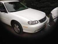 This 2005 Chevy Malibu class sedan in white has grey