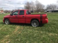 This 2005 Dodge Ram 1500 SRT10 in Flame Red Clearcoat