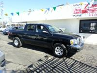 SLT 4dr Quad Cab 4WD SB V8 MAGNUM MANUAL TRANS VERY