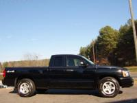 Options Included: Great Driving Extended Cab Dakota SLT