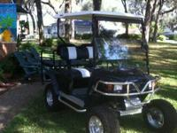 "Golf cart has all the extras, Sport front end; 5"" Jakes"