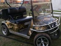 2005 EZ Go Electric Golf cart with dump bed. Brand new