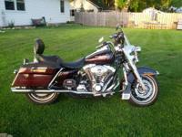A beautiful bike!!! Black cherry pearl Road King comes