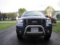 An 05 ford f150 triton stx supercab 4 door ,automatic