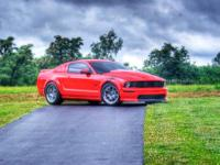 I am selling a 2005 Mustang GT Torch Red with Charcoal