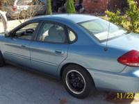 2005 Ford Taurus, with approximately 84,000 miles,