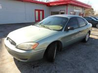 2005 FORD TAURUS SE AUTOMATIC GRAY ON TAN WITH 135K.