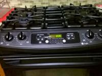 2005 GE Profile four burner with a warmer stand alone