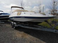 This 2005 Glastron DX 235 deckboat has a full