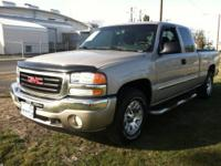 From mountains to mud, this Gray 2005 Gmc Sierra 1500