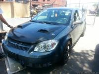 2005 GREY CHEVY COBALT 4 CYLINDER, 4 DOOR, SITS 5, CITY