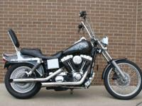 The Dyna Wide Glide. Grab hold and the road to