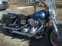 Have a 2005 super glide with low miles for sell. Lots
