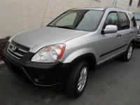 This 2005 Honda CR-V 4dr EX AWD SUV features a 2.4L L4