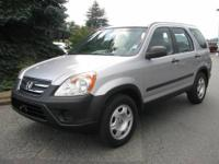 This 2005 Honda CR-V LX AWD is Silver with Black