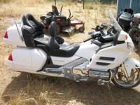 Spend $24,000 and buy a new goldwing or spend