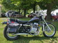 2005 Honda Rebel 250 with devices. The bike resembles