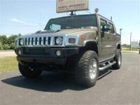 This is a Hummer, H2 for sale by Beebe's Motors. The