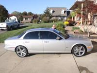 2005 Jaguar XJR (Supercharged) sedan. Silver in color