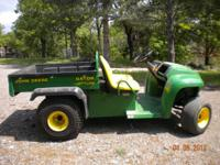 2005 John Deere Gator utility vehicle with power cargo