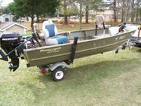 2005 Roughneck 14 foot simi v jon boat that is loaded.