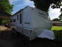 2005 Keystone Outback 23rs Camper. Sleeps 9 with a