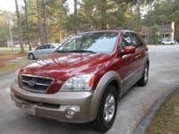 2005 Kia Sorento SUV EX Burgundy with light tan