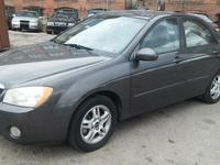 for sale is a 2005 kia spectra- it is a automatic, four