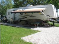 In Excellent condition with Four slide outs, Sleeps 4.