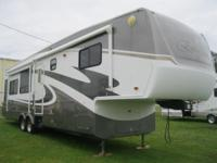 This beautiful fifth wheel weighs 13165 and has