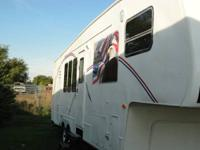 We have for sale a 32ft camper with two slides.  It is