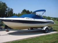 A sleek 20-foot open-bow boat with swim platform,