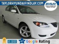 2005 White Mazda Mazda3 i    34/26 Highway/City MPG