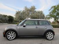 This ONE OWNER 2005 Mini Cooper S is SILVER with BLACK