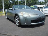 Touring trim. Heated Leather Seats, Multi-CD Changer,