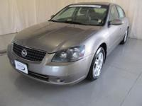 Options Included: Front Wheel Drive, Wheel Covers,