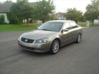 2005 Brown Nissan Altima 3.5SE with 113k miles on it