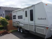 2005 Outback 23ft rear slide made by Keystone. Has new