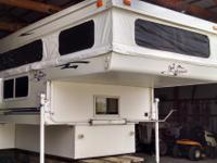 2005 Palomino Bronco 1250 popup truck camper. Has seen